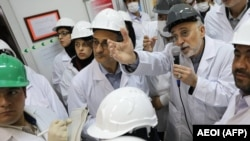 IRAN -- Head of the Atomic Energy Organisation of Iran (AEOI), Ali Akbar Salehi (2nd-R)) addresses workers during a visit at the nuclear power plant of Natanz, November 4, 2019