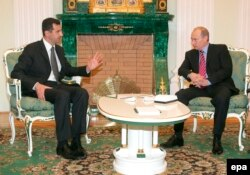 Russian President Vladimir Putin (right) and Syrian President Bashar al-Assad met in Moscow in 2006. Putin's intentions in Syria are likely to be the most closely watched portions of his UN speech.