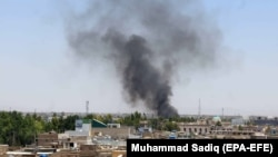 Smoke billows from the scene of a bomb explosion in Kandahar on May 22.