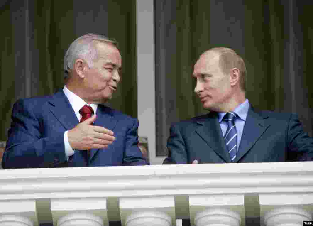 President Islam Karimov (left) with Russian President Vladimir Putin during a meeting in the Black Sea resort of Sochi in May 2006 - At the same time, Uzbekistan has moved forward with a diplomatic swing toward the Shanghai group of states, which includes Russia, China, and others who have not been critical over Andijon.