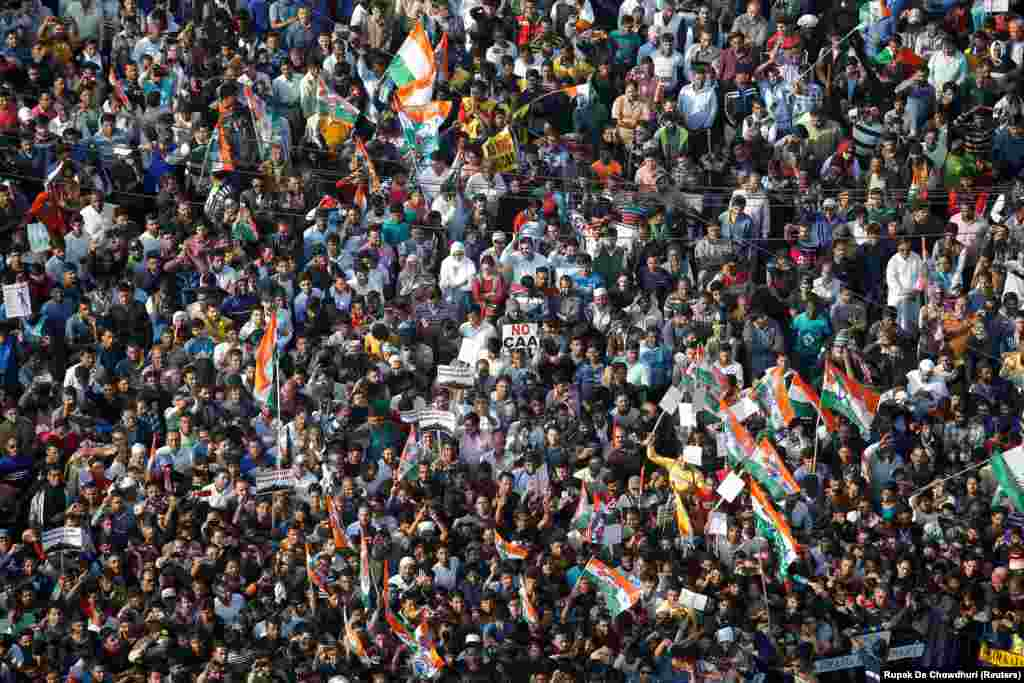 Supporters of Mamata Banerjee, the Chief Minister of West Bengal, attend a protest march against the new citizenship law, in Kolkata, on December 18.