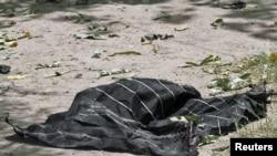 На месте гибели мэра Кандагара Гуляма Хайдара Хамиди, 27 июля 2011 года.