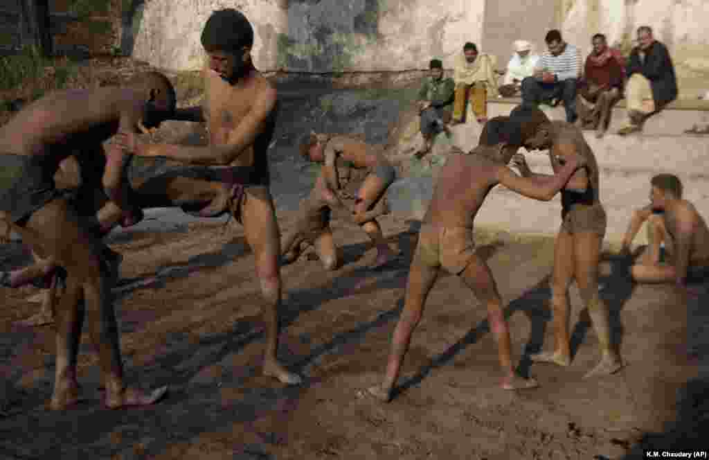 Wrestlers practice the national sport of kushti during a training session in Lahore, Pakistan. Kushti, also known as pehlwani, is a several-thousand-year-old sport and is practiced on the Indian subcontinent. The wrestlers train and compete on dirt floors, cleared of stones and dyed red. (AP/K.M. Chaudary)