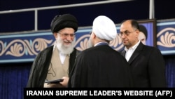 Vahid Haqqanian seen next to the Supreme Leader in Rouhani's inauguration.