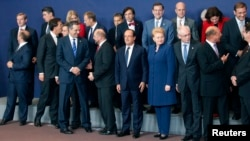 European Union leaders pose for a photo during the Brussels summit on October 24.