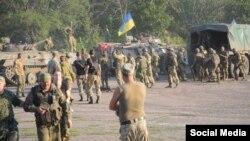Українські військові після бою під Старогнатівкою, 10 серпня 2015 року (Фото: начмед «Госпітальєрів» Яна Зінкевич)
