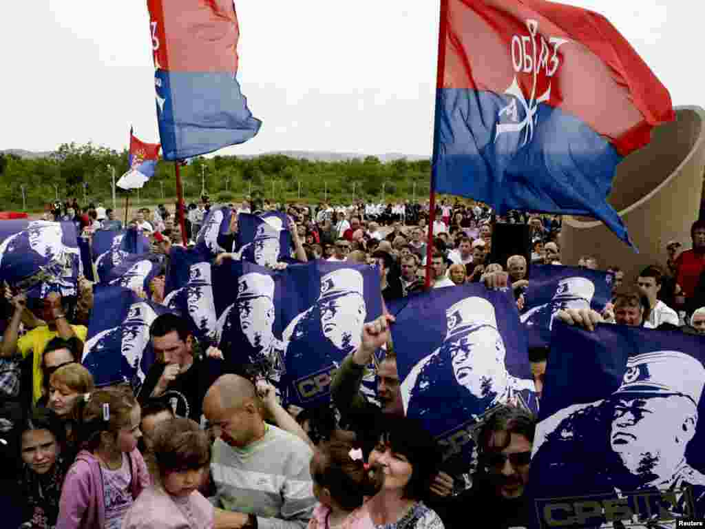 Serbs hold posters of former Bosnian Serb wartime military commander Ratko Mladic at an event to mark the battle anniversary in Gazimestan in 2011.