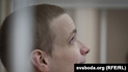 Mikita Likhavid in a guarded cage during a court hearing in Minsk on March 22