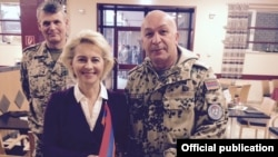 Afghanistan- Germany's Defense Minister Ursula von der Leyen poses for a photograph with the commander of Armenian troops at Camp Marmal, near Mazar-e Sharif, 7Dec2015.