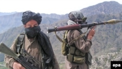 Taliban fighters patrol outside the Swat Valley near Buner district.