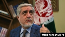 Afghan presidential candidates Abdullah Abdullah gestures as he speaks during an interview with AFP at the Sapedar Palace in Kabul on November 5.