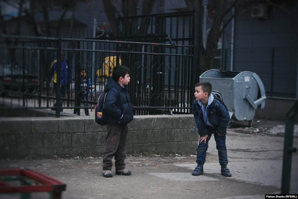 Schoolkids on the street in Fushe-Kosove, photographed by Flakon Zharku. The 17-year-old says he studied the requirements of the photo project carefully and decided to photograph the neighborhood around his house.