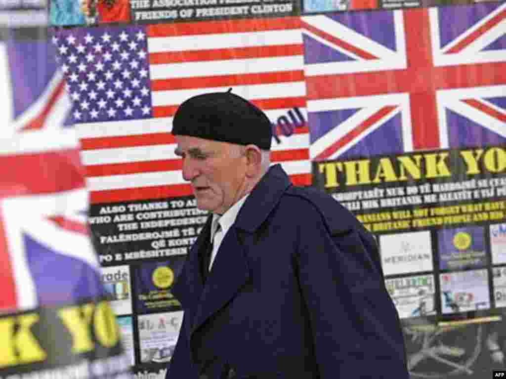 "In Pristina, posters with British and U.S. flags read ""Thank You."" The United States and major European Union countries are expected to recognize the new state."
