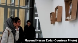 "Visitors view Zada's ""Memory Box"" exhibition at the French Cultural Center in Kabul."