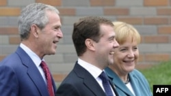 George Bush, Dmitry Medvedev, and Angela Merkel at the G8 summit