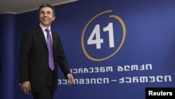 Georgia -- Presidential candidate Bidzina Ivanishvili arrives for a news conference at his office in Tbilisi, 02Oct2012