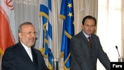 Димитрис Друцас (десно)