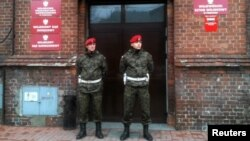 Poland -- Military police stand guard outside the military prosecutor's office in Poznan, 09Jan2012