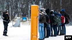 Мигранты на российско-норвежской границе.