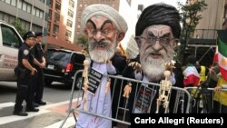 People dressed as Iran's Supreme Leader, Ayatollah Ali Khamenei and Iranian President Hassan Rohani protest on the street against Iran in New York, New York, September 24, 2018