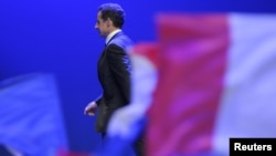 Nicolas Sarkozy leaves the stage after a speech following his reelection defeat in May in a runoff vote against Socialist Francois Hollande.
