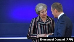 Theresa May și Donald Tusk, octombrie 2018