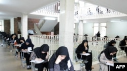 Students sit for their university entrance exam in Tehran in June.