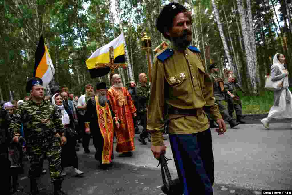 Bullwhip in hand, a Cossack walks ahead of the procession. The marchers followed the route taken by the Bolsheviks as they drove the bodies to a forest north of Yekaterinburg for a hasty burial.