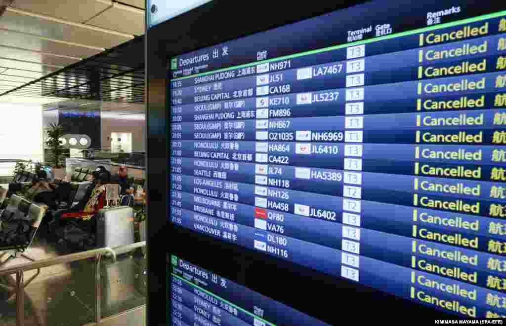 The departures board at Tokyo International Airport on April 14 shows that all flights were canceled.