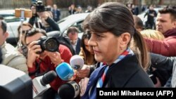 Laura Codruta Koevesi is surrounded by reporters as she arrives for a hearing at the Special Investigative Section for Prosecutors headquarters in Bucharest on March 7.