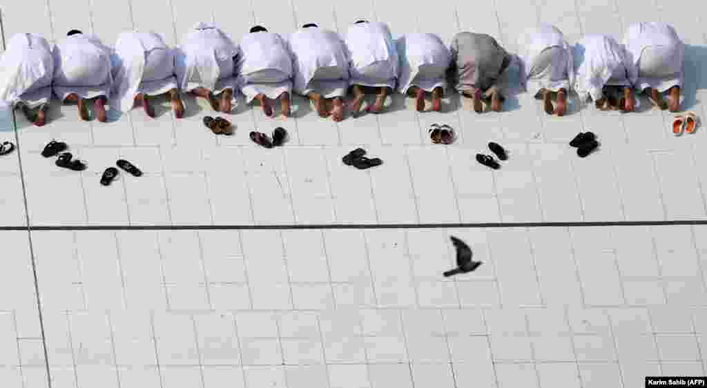 Muslim worshippers perform prayers around the Kaaba, Islam's holiest shrine, at the Grand Mosque in Saudi Arabia's holy city of Mecca, prior to the start of the annual hajj pilgrimage. (AFP/ Karim Sahib)