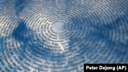 The sky is reflected in the national MH17 monument in Vijfhuizen, the Netherlands, that carries the names of all 298 victims.