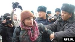 Police detain Maksim Kuleshov during a march in Bishkek in February 2008.