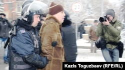Kazakh police arrest people protesting in the country's main city, Almaty, over the events in Zhanaozen on December 17.