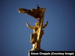 The golden statue of Niyazov no longer rotates with the sun.