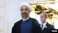 Президент Ирана Хасан Роухани (слева) и президент России Владимир Путин на саммите глав государств - членов ШОС (Шанхайской организации сотрудничества). Душанбе, 12 сентября 2014 года.
