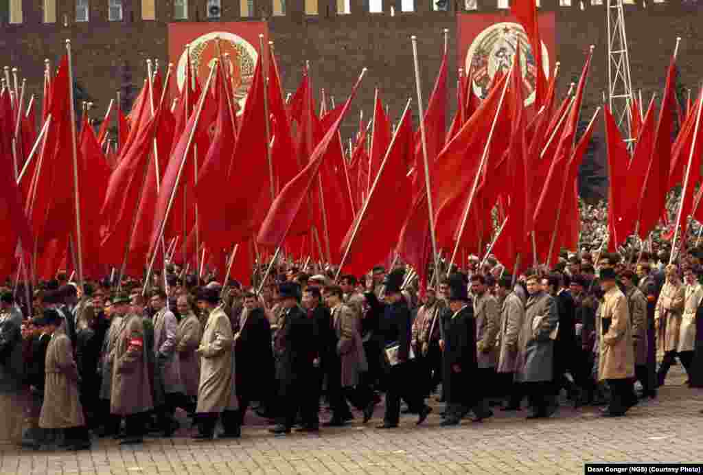 Behind the Iron Curtain: Workers parade through Red Square on May Day in 1964.