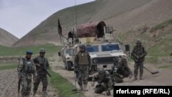 An Afghan army land mine detection team in the northern Faryab province on June 13.