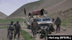Служащие афганской армии в провинции Фарьяб. 13 июля 2015 года.