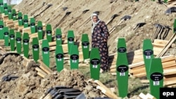 The burial on July 11 of 308 newly identified victims killed by Bosnian Serb forces in Srebrenica
