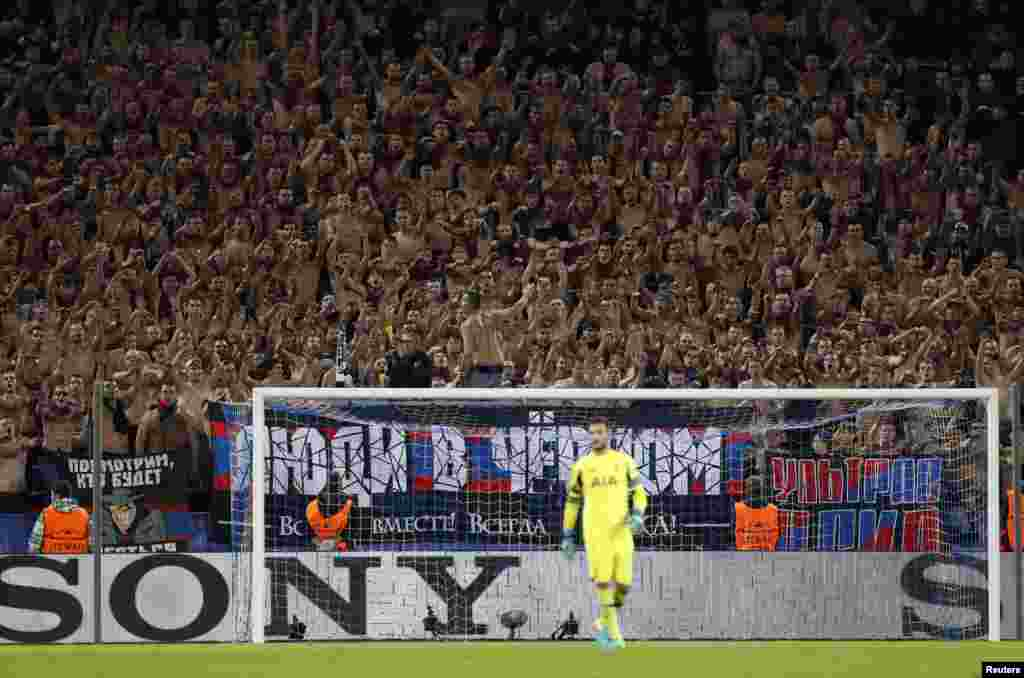 Shirtless CSKA Moscow fans, aka the Red-Blue Warriors, cheer on their team behind Hugo Lloris in the Tottenham goal during the Champions League Group E match at the Arena CSKA in Moscow on September 27. (Reuters/John Sibley)