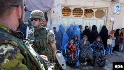 Italian ISAF soldiers stand guard during the launch ceremony of a girls high school, funded by the Italian PRT, in Herat in September 2009.