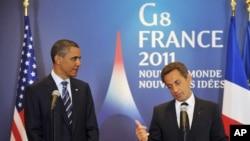 АҚШ президенті Барак Обама (сол жақта) мен оның франциялық әріптесі Николя Саркози. Довиль, 27 мамыр 2011 жыл.