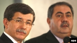 Ahmet Davutoglu (left) was previously chief foreign-policy adviser to Prime Minister Erdogan.