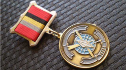 A medal with the emblem of GRU military unit No. 74455
