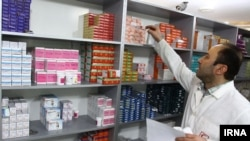 As the value of Iran's currency drops, there are shortages of imported medicines.