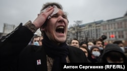An injured protester expresses his rage at riot police in Moscow on January 23.