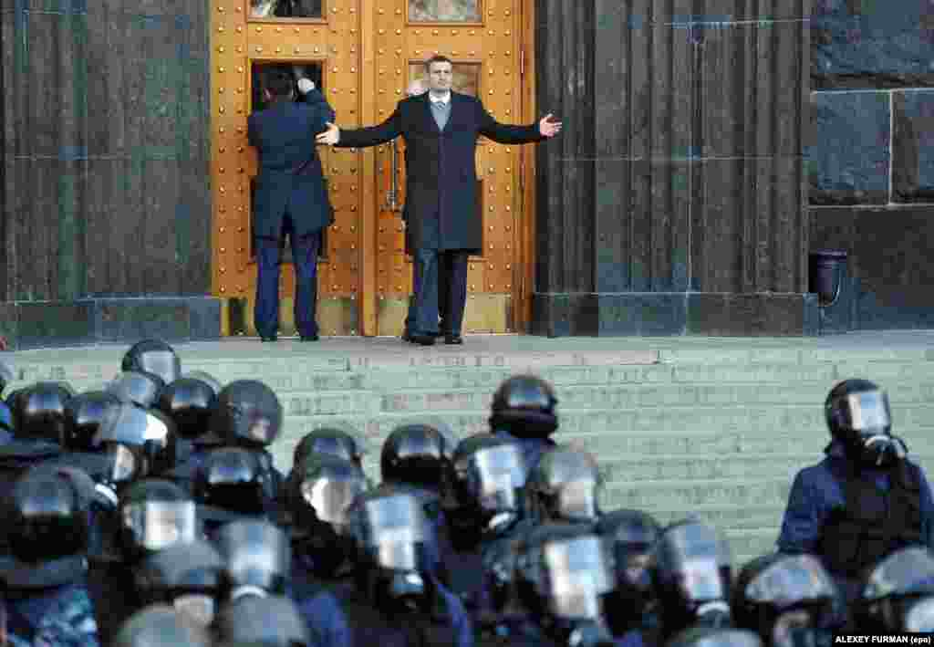 Opposition leader Vitali Klitschko gestures during an opposition rally in front of the Cabinet of Ministers building in downtown Kyiv.
