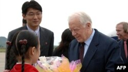 Former U.S. President Jimmy Carter (right) at Pyongyang airport