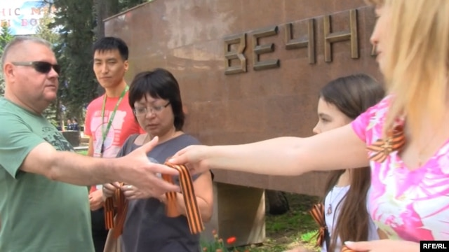 Pro-Russia activists hand out St. George Ribbons in Kazakhstan ahead of Victory Day celebrations on May 9.